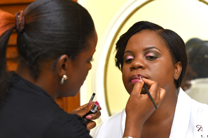 Jamaican Bridal Hairstylist and Makeup that are passionate about her work.